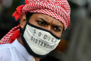 A Muslim wearing a face mask comes out of Masjid-e-Eidgah Bilal after offering prayers during the Eid al-Adha, the feast of sacrifice, in Bangalore on August 1, 2020.