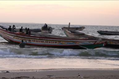 African migrants seeking to cross to the Canary Islands typically travel in small wooden boats like these. Smugglers' vessels are notoriously prone to engine failure and overloading.