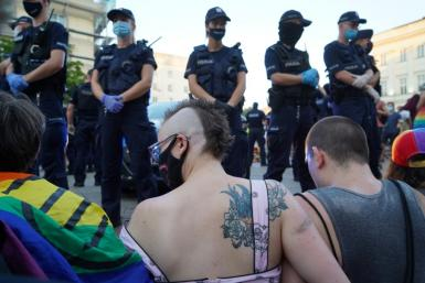 LGBT activists blocked a police vehicle