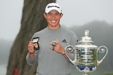 American Collin Morikawa celebrates with the Wanamaker Trophy after the 2020 PGA Championship at TPC Harding Park in San Francisco