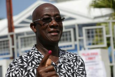 Trinidad and Tobago's Prime Minister Keith Rowley shows the indelible ink mark on his finger after casting his vote at a polling station west of Port-of-Spain on August 10, 2020