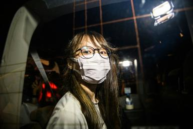 Agnes Chow was arrested by police officers with Hong Kong's new national security unit