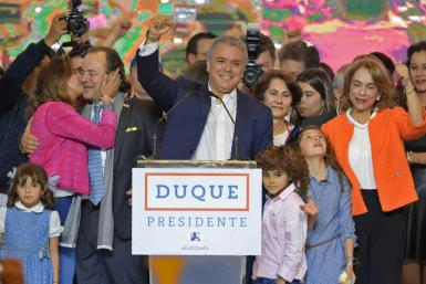 Colombian President Ivan Duque (center) -- seen here celebrating his election victory in June 2018 alongside his family -- is now under investigation for alleged campaign finance violations
