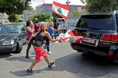 Lebanese protesters make an abortive attempt to disupt a session of parliament at which it backed the emergency powers assumed by the government