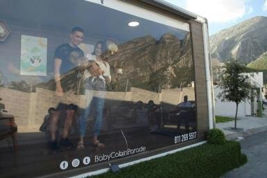 """Baby cabin"": new parents show their newborns to families from a special truck"