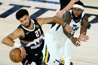Denver Nuggets Jamal Murray (L) drives against Royce O'Neale of the Utah Jazz during the first half of an NBA playoff game in Florida