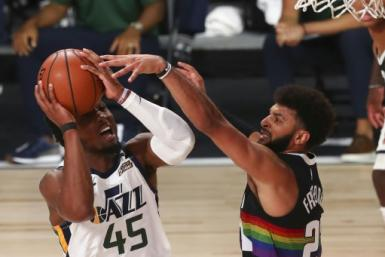 Utah's Donovan Mitchell fires against Jamal Murray of Denver in the Jazz's 124-105 NBA playoff victory over the Nuggets