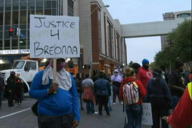 Protesters gather in downtown Louisville, Kentucky, to demand justice after charges were filed against only one officer involved in the fatal shooting of Breonna Taylor, a 26-year-old black woman whose name has become a rallying cry of the Black Lives Mat