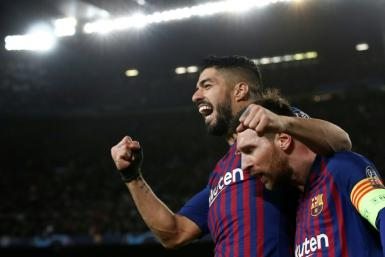 Teammates no more: Luis Suarez struck up a strong friendship with Lionel Messi at Barcelona, but the Urugayan's transfer to Atletico Madrid has been confirmed