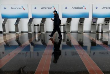 American Airlines is to start furloughing thousands of workers on October 1, the company said