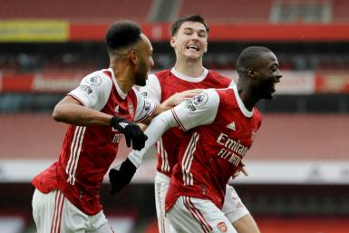 All smiles: Nicolas Pepe's (right) goal gave Arsenal a 2-1 win over Sheffield United