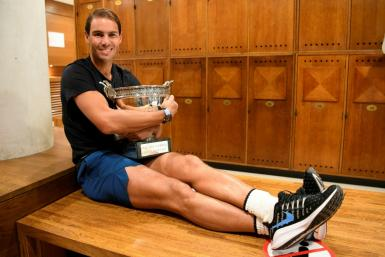 Sitting pretty: Rafael Nadal posing with The Mousquetaires Cup