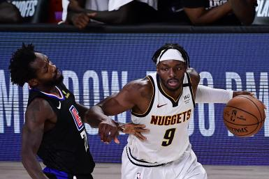 Jerami Grant #9 of the Denver Nuggets drives the ball against Patrick Beverley #21 of the LA Clippers