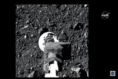 Osiris-Rex's robotic arm makes contact with asteroid Bennu to collect samples