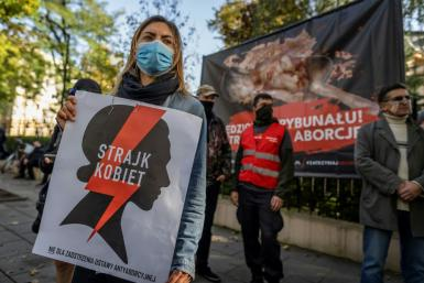 Protesters outside Poland's constitutional court on Thursday, which has opened the door for the country's abortion laws to be tightened