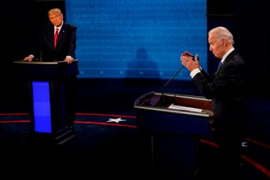 President Donald Trump (L) and Democratic candidate Joe Biden take part in the final presidential debate in Nashville, Tennessee