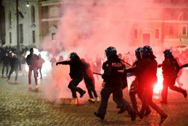 The new restrictions came hours after neo-fascists opposed to the curfew clashed with riot police in Rome
