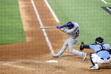 Max Muncy of the Los Angeles Dodgers hits a solo home run in a 4-2 win over the Tampa Bay Rays in game five of baseball's World Series