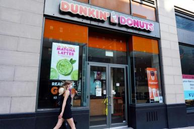Shares of Dunkin' Brands surged as it confirmed talks to potentially be acquired