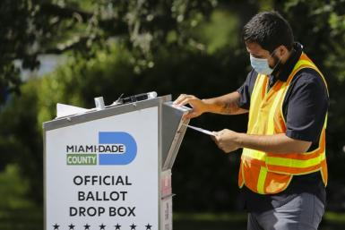 Voters began in-person balloting Tuesday after a tumultuous US election campaign and weeks of early and mail-in voting