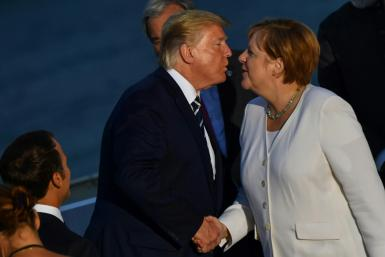 US President Donald Trump kisses German Chancellor Angela Merkel in greeting, but more often their relationship has been frosty and tense
