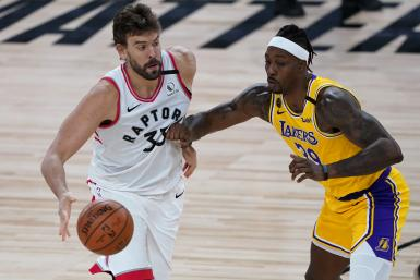 Marc Gasol #33 of the Toronto Raptors drives against Dwight Howard #39 of the Los Angeles Lakers