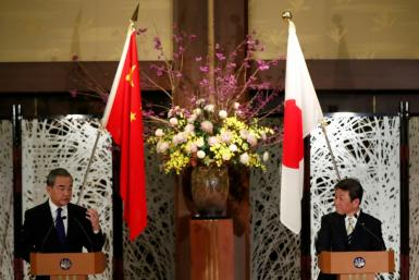China's State Councillor and Foreign Minister Wang Yi (left) and his Japanese counterpart Toshimitsu Motegi held talks in Tokyo