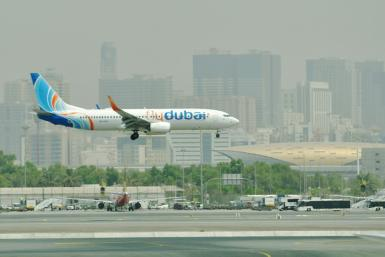 A flydubai Boing 737-800 lands at Dubai International Airport.