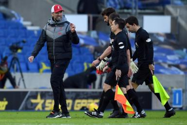 Liverpool boss Jurgen Klopp (left) was left frustrated by dropped points, VAR reviews and another injury after a 1-1 draw at Brighton