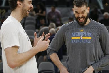 Pau Gasol #16 of the San Antonio Spurs chats with brother Marc Gasol #33 of the Memphis Grizzlies