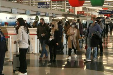 Top US scientist Anthony Fauci voiced his fears for a virus surge as millions of travelers returned home after the Thanksgiving holiday
