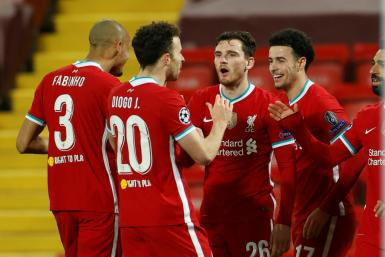 Curtis Jones celebrates with teammates after scoring Liverpool's winner against Ajax