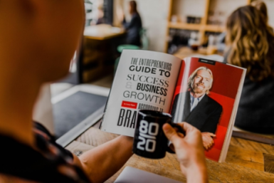A Man Reading a book about Business Growth