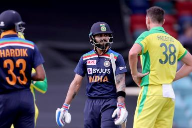 India captain Virat Kohli (C) was dismissed by Australia's Josh Hazlewood (R)
