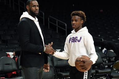 LeBron James #23 of the Los Angeles Lakers and his son LeBron James Jr., on the court after the Los Angeles Clippers and Los Angeles Lakers basketball game at Staples Center