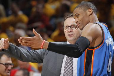 Head Coach Scott Brooks of the Oklahoma City Thunder coaches Russell Westbrook #0 against the Cleveland Cavaliers