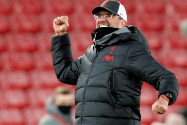 Jurgen Klopp celebrates Liverpool's 4-0 win against Wolves in front of the fans at Anfield