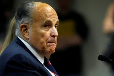 Rudy Giuliani, personal lawyer of US President Donald Trump, looks on during an appearance in Michigan