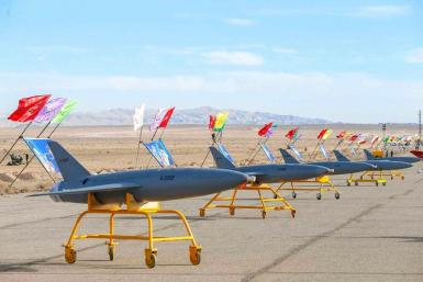 A handout photo issued on January 5, 2021 by the Iranian army shows drones on display prior to a military drill