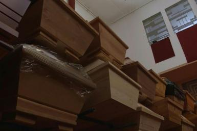 As Germany's Meissen crematorium struggles to cope with an explosion in deaths from the coronavirus pandemic in the region, coffins are stacked up to three high or even stored in hallways awaiting cremation. Largely spared in the first wave of the outbrea