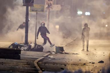 Protesters clash with security forces in a suburb on the northwestwern outskirts of Tunisia's capital on Sunday