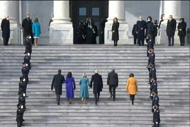 Joe Biden and Kamala Harris arrive at the Capitol for inauguration ceremony