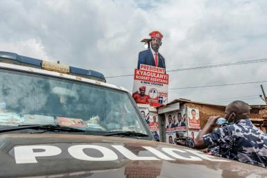 A police patrol car stationed outside the headquarters of Uganda's main oppposition party, the National Unity Platform