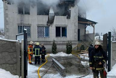 Firefighters work at the site of a fire in a nursing home in Kharkiv on January 21, 2021.