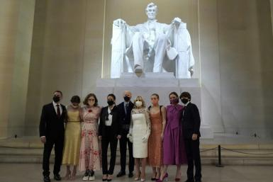 "The new ""first family"" of the United States pose in front of a statue of Abraham Lincoln while wearing face masks following Joe Biden's inauguration"