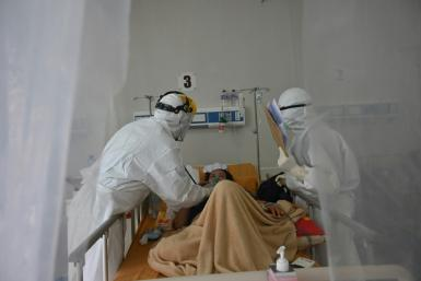 Some hospitals are on the brink of collapse in Indonesia as they are overwhelmed with patients, public health experts warn