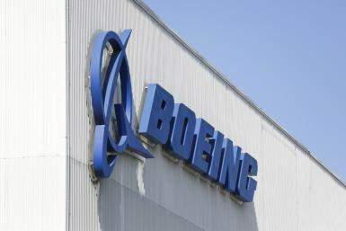 Boeing reported an $11.9 billion annual loss following one-time costs on the delayed 777X plane program