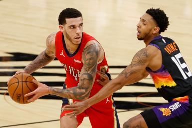 Lonzo Ball #2 of the New Orleans Pelicans looks to pass against Cameron Payne #15 of the Phoenix Suns