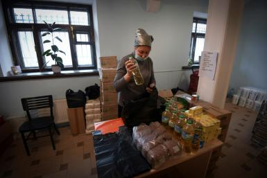 A social worker at Miloserdie (Mercy), one of Russia's best known charities, tells AFP: 'It's a heavy workload'
