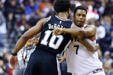 DeMar DeRozan #10 of the San Antonio Spurs hugs Kyle Lowry #7 of the Toronto Raptors